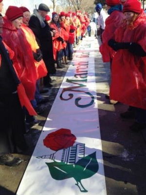 The March leaders from Benedictine College with Archbishop Naumann lay down the banner in front of the Supreme Court.