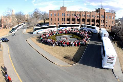 Eight buses and nearly 400 students ready themselves to leave Atchison for Washington, D.C.