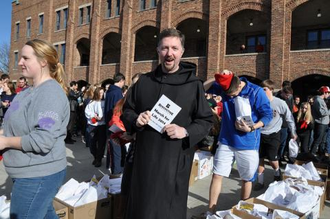 College Chaplain Father Brendan Rolling also marched as a Benedictine student.