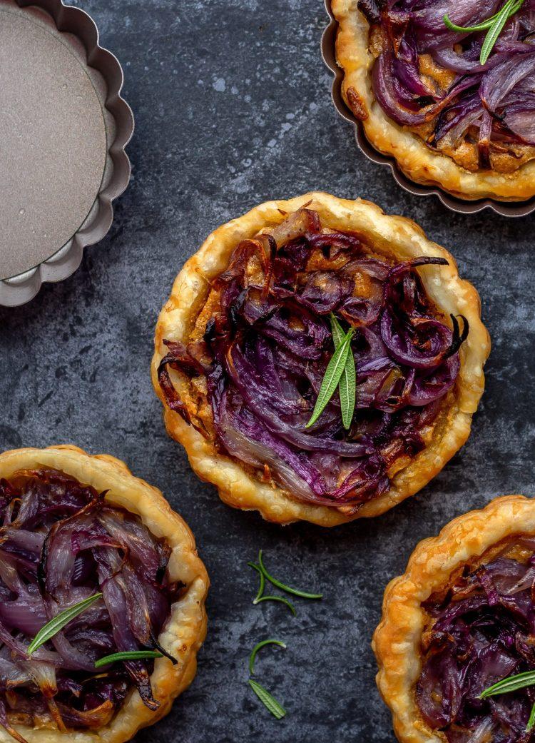vegan onion tartlets on dark background