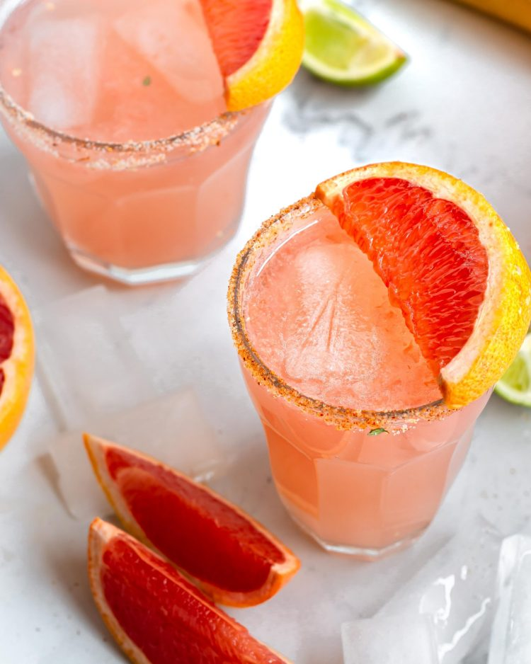 Pink drink in a glass with garnish