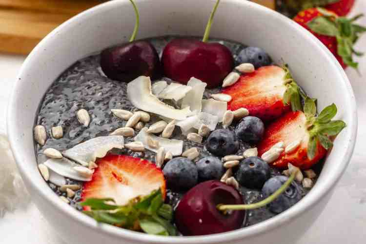 lemon blueberry chia pudding in a bowl with fruits
