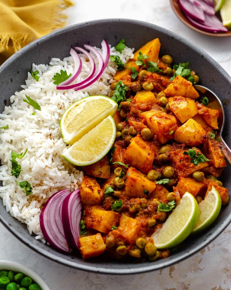 south indian potato and pea curry in a bowl with rice