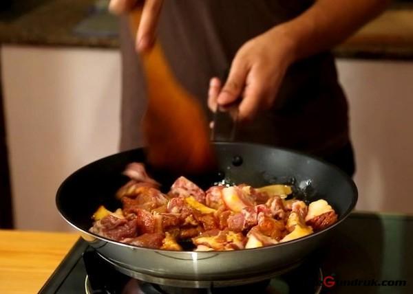 frying pork meat