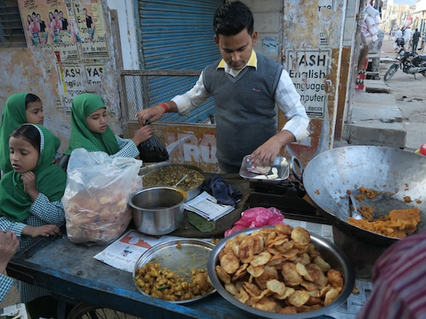 Selling chana puri and haluwa at Tribhuwan Chowk