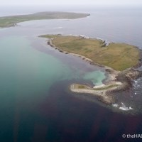 A small island with a smaller island and a smallest island