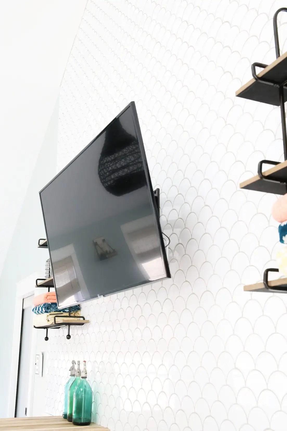hang a tv on a tile wall