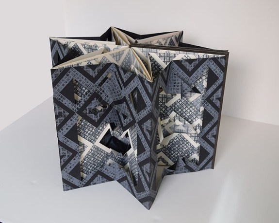 Tatiana Potts (Maryville, TN) Faces of Tajtania, Carousel Book Silkscreen, relief, folded and cut paper