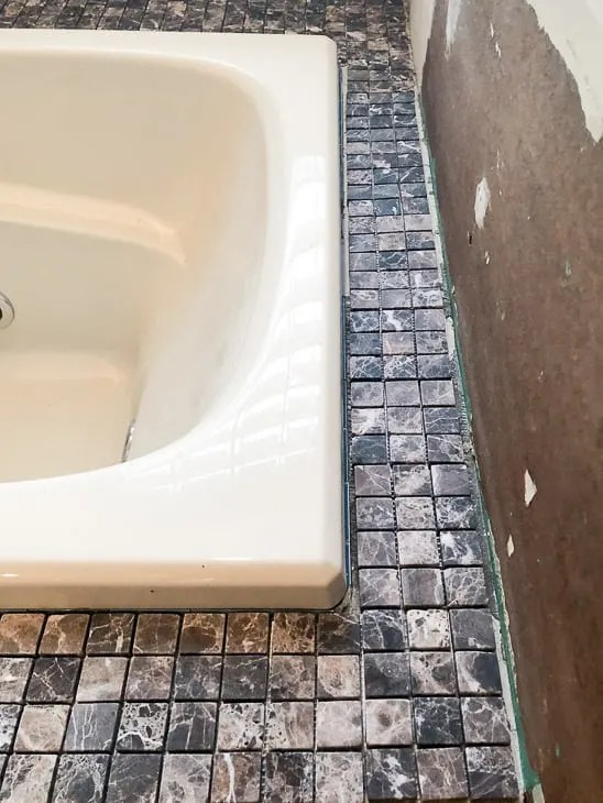 how to tile a bathtub surround the