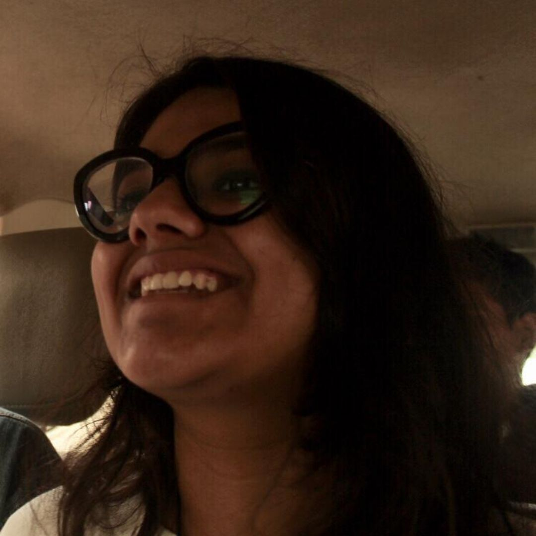 girl wearing glasses and smiling