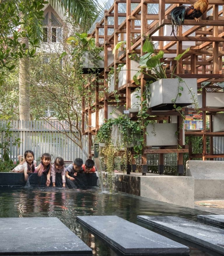 children playing in water at library vietnam