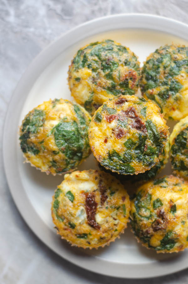 These Mediterranean egg cups are the perfect breakfast for busy mornings. You can make it ahead on the weekends and enjoy them throughout the entire week! Keto, grain-free.
