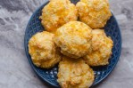These gluten-free cheddar garlic biscuits are salty, crispy and soft and warm on the inside! Keto, low-carb, gluten-free, grain-free.