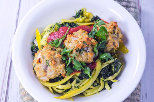 Whole30 compliant spaghetti and meatballs? Yes, please! These are made with squash noodles and tons of fresh veggies. Gluten-free, grain-free, dairy-free, Whole30, Paleo.