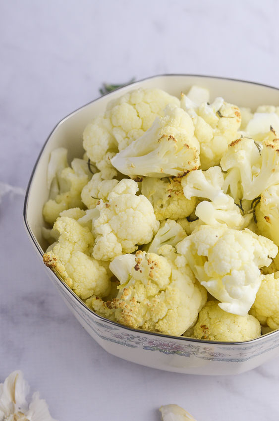 This roasted rosemary garlic cauliflower is sure to please a crowd! Dairy-free, low-carb, keto, paleo and Whole30 compliant!