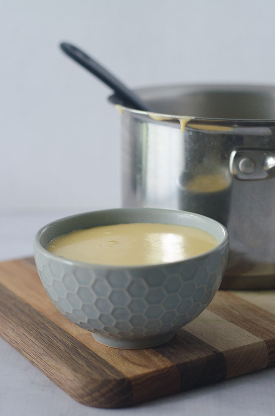 A delicious and incredibly simple three-ingredient queso dip. All you need is heavy cream or coconut milk, cheese and jalapenos. Simply simmer to thicken the milk and stir in the cheese and jalapenos. It doesn't get much easier! Gluten-free, grain-free, ketogenic, low-carb.