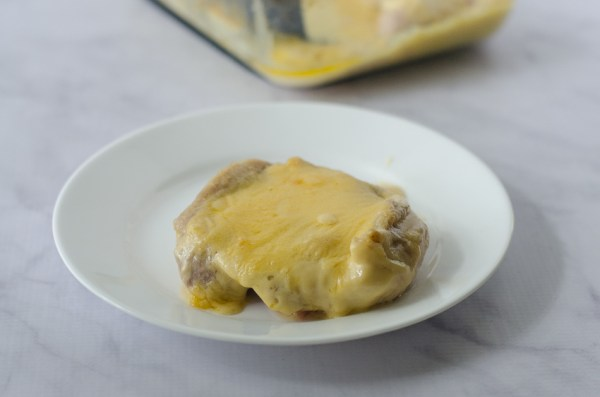 These delicious queso-smothered chicken thighs are SO simple to make. All you need is my three-ingredient queso dip recipe, some chicken thighs and an oven! Gluten-free, grain-free, low-carb, ketogenic.