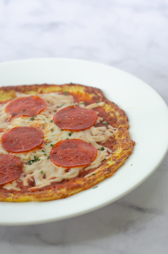 An incredibly simple two-ingredient skillet pizza crust recipe that is much simpler and faster than a traditional pizza. Made entirely on the stove, it's great for those without a working oven, or if you desire something a little different! Gluten-free, grain-free, low-carb, ketogenic.