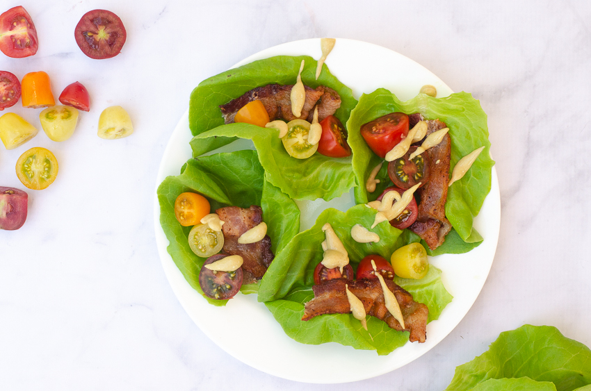These BLT lettuce wraps are one of the easiest recipes you can imagine! All you have to do is cook up your favorite bacon, then toss it into a lettuce leaf with some fresh tomatoes and drizzle on your favorite dressing! Ketogenic, low-carb, Paleo, Whole30, gluten-free, grain-free, dairy-free.
