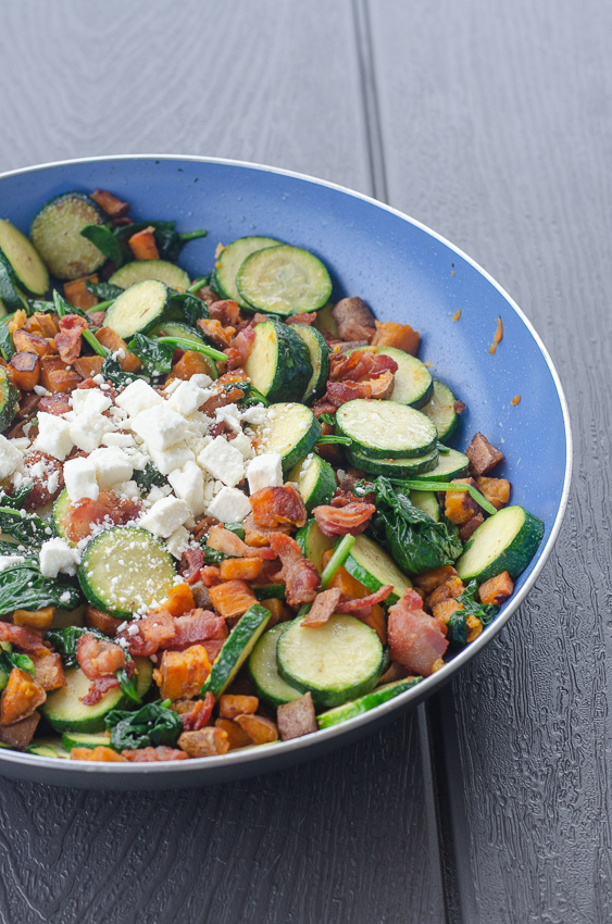 A simple one pan meal, this sweet potato, bacon and feta skillet is also filled with lots of veggies! Well rounded and delicious, a huge hit for the whole family! Gluten-free, grain-free, and easy to make Paleo and Whole30 by omitting the feta.