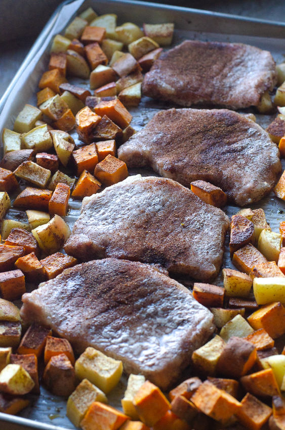Looking for a hearty, healthy meal for colder weather? These sheet pan spiced pork chops and veggies are an easy and delicious meal! Paleo, Whole30, gluten-free, grain-free.