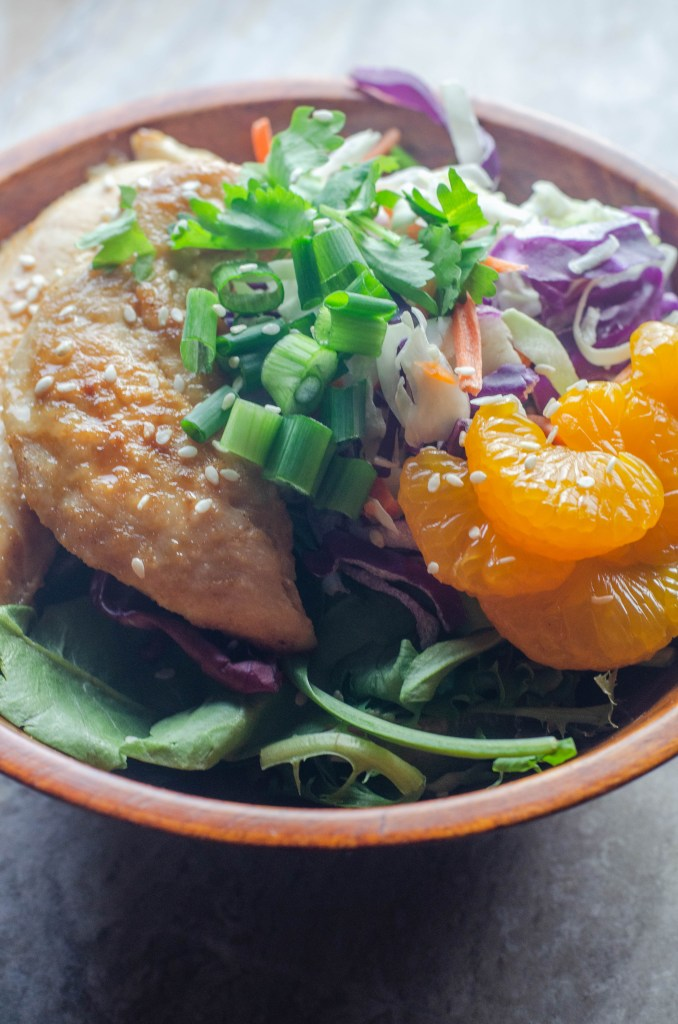 This sesame chicken and cabbage salad is a delicious flavorful salad, for when you are tired of boring lettuce, tomato and cucumber salads. Whole30, low-carb, paleo.