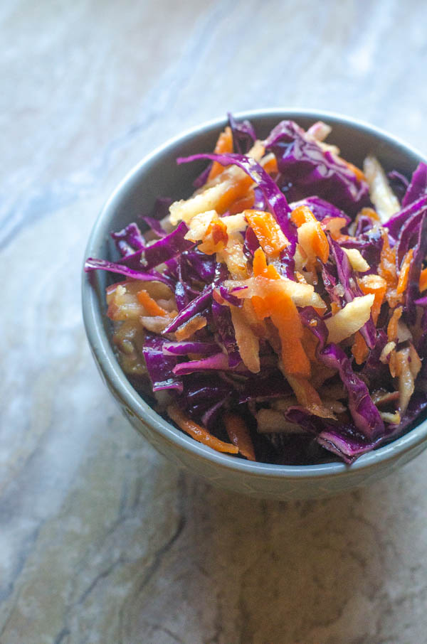 A delicious side dish, this apple cabbage slaw is tasty and super-simple to make! Paleo, Whole30, dairy-free, gluten-free, vegan.