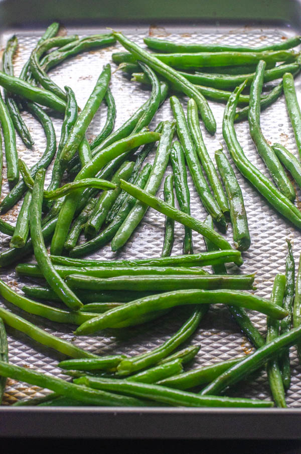 These roasted garlic green beans are incredibly flavorful and gourmet, but also incredibly simple to make! Low-carb, Paleo, Whole30, vegan.