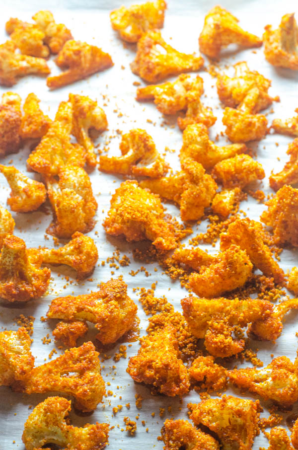 A delicious low-carb side dish or appetizer, these shake 'n bake cauliflower bites are easy to make and super tasty! Paleo, Whole30, vegan, keto.