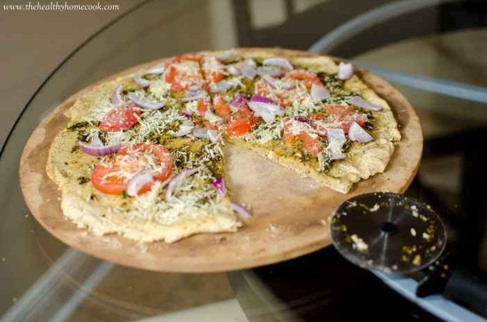 Pesto Pizza with Chickpea Crust- For those of us that deal with celiac disease or a gluten intolerance, don't worry, we can still enjoy all the deliciousness of a good pizza crust.