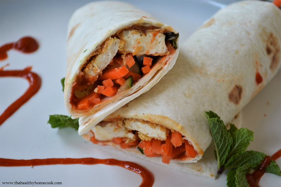 Crunchy tofu, fresh vegetables and a spicy homemade peanut sauce all come together to create this perfectly composed Crispy Thai Tofu Wrap.
