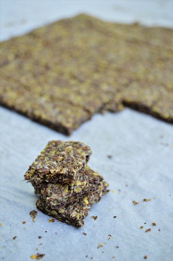 These Homemade Flax Crackers are thin, flaky, vegan and gluten free.  A delicious homemade snack perfect for your entire family including kids!