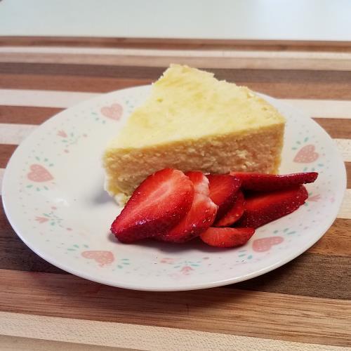 lemon sticky cake with sliced strawberries