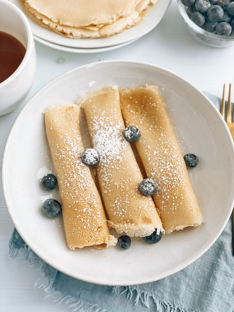 Plate of norwegian pancakes with powdered sugar