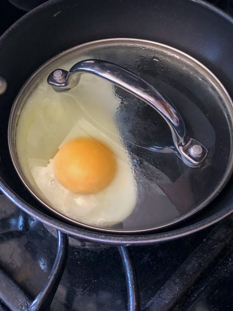 Covering egg with pot lid