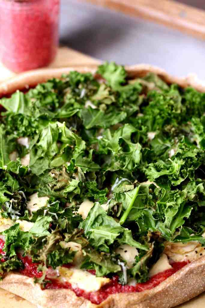 Roasted kale chicken pizza with cheesy walnut beet sauce