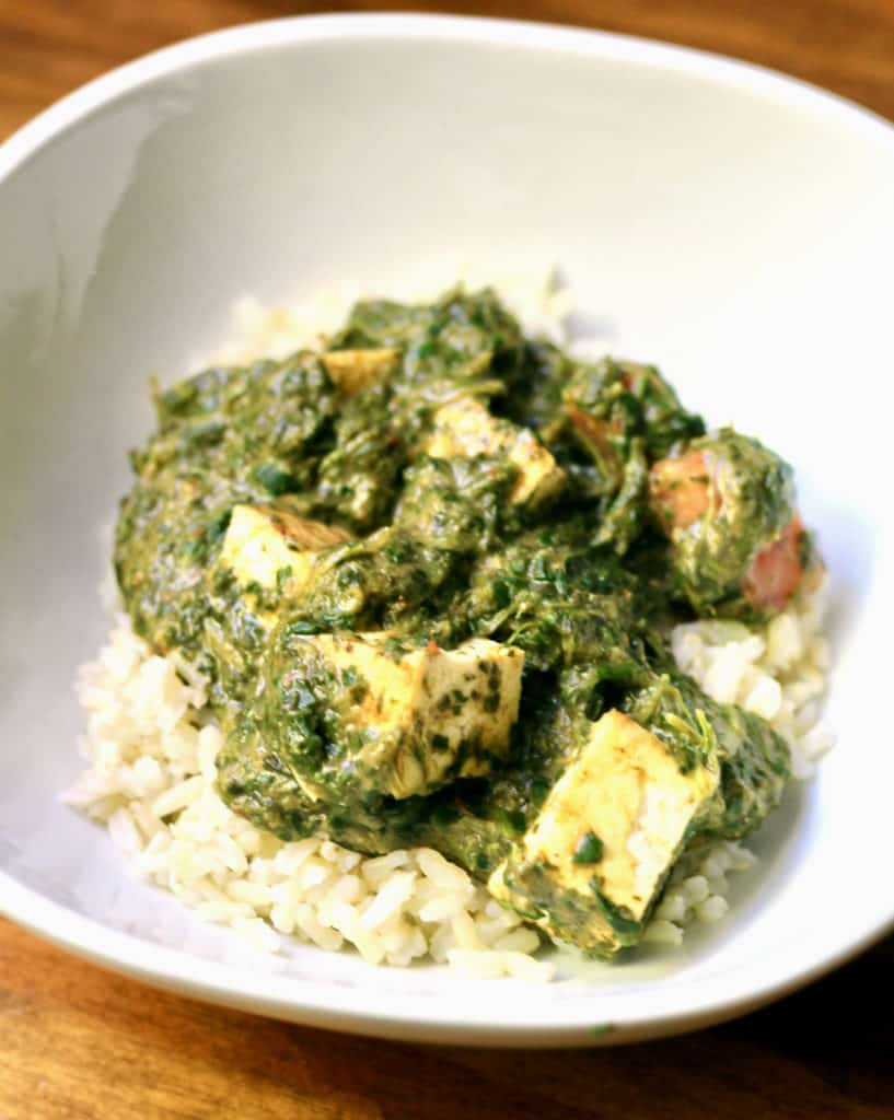 Bowl of healthy palak tofu over rice