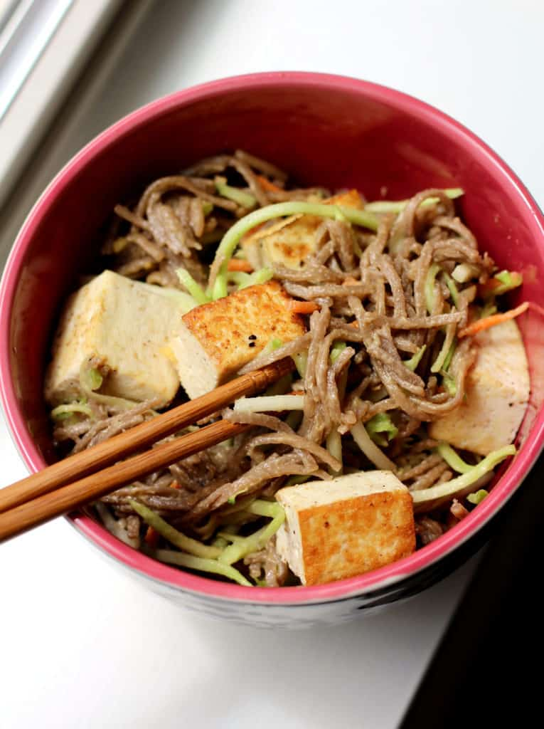 Bowl of cold soba noodles with tofu and lemon almond dressing