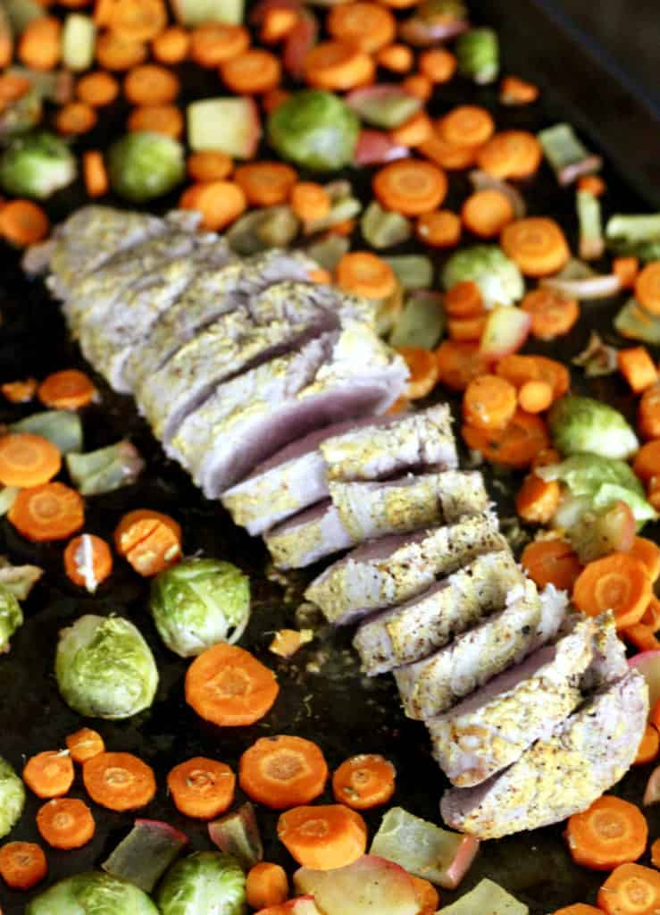 Slice pork with roasted vegetables on sheet pan