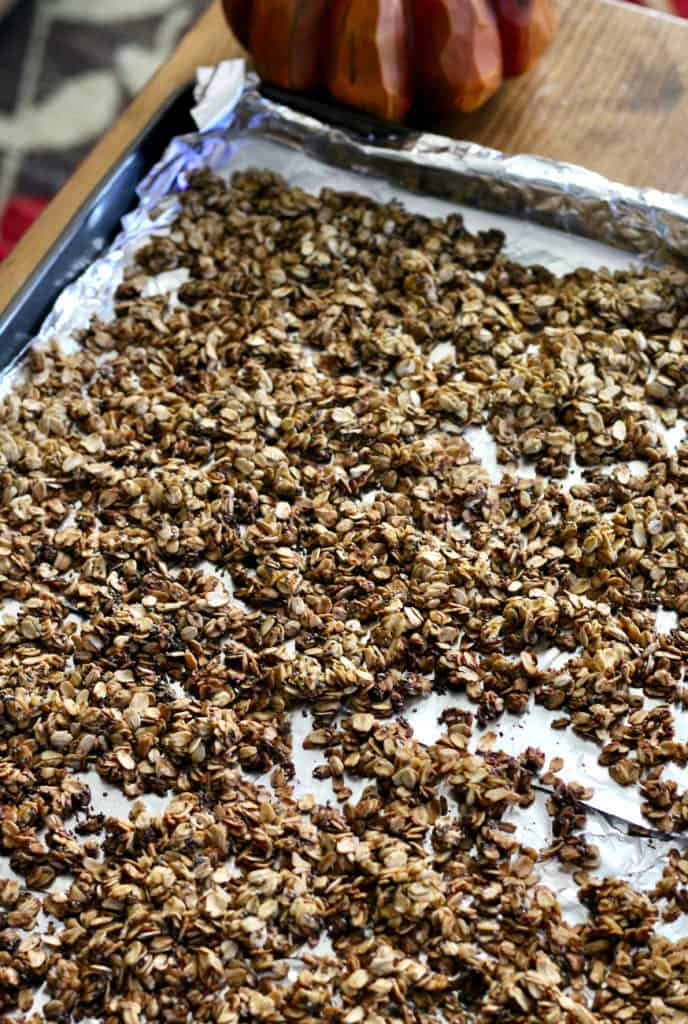 Healthy pumpkin spice granola on a large baking sheet