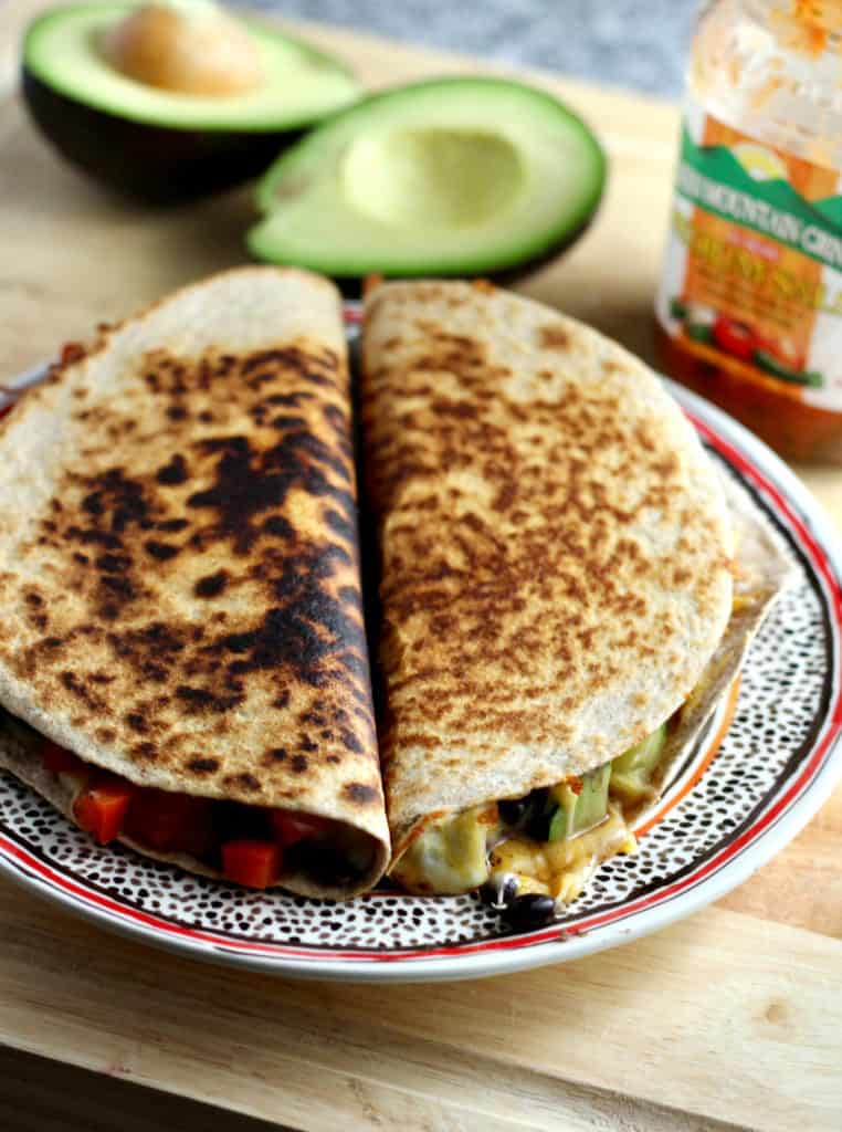 Uncut veggie quesadillas on plate