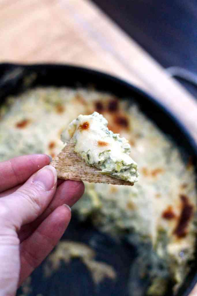 Lightened up spinach artichoke dip on triscuit