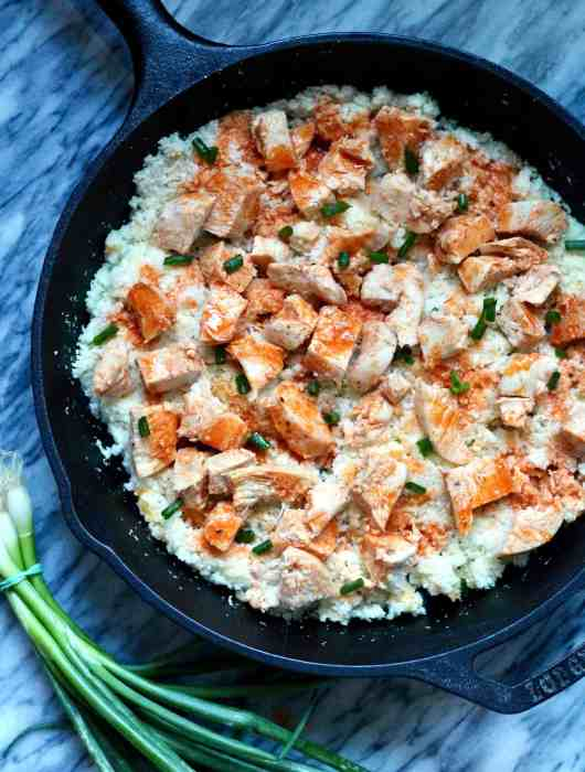 Easy buffalo chicken with cauliflower rice in cast iron pan
