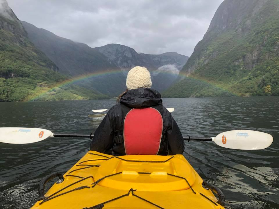 Rainbow across a fijord while kayaking