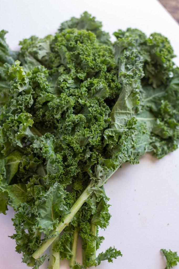 Curly kale on cutting board