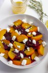 Plate of rosted beet salad with goat cheese and lemon dressing