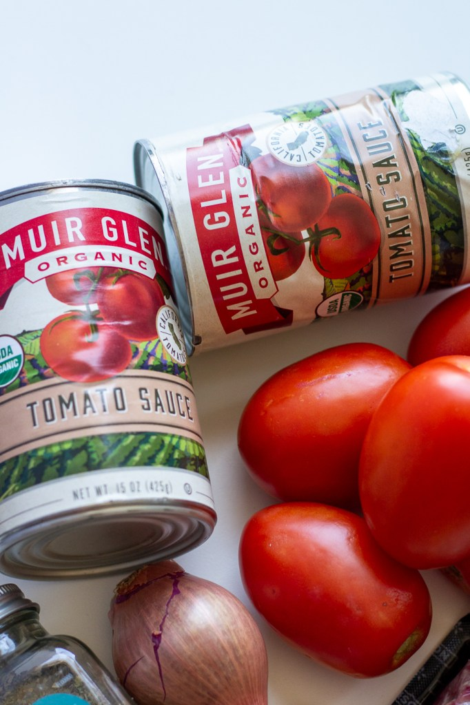 Cans of Muir Glen tomato sauce
