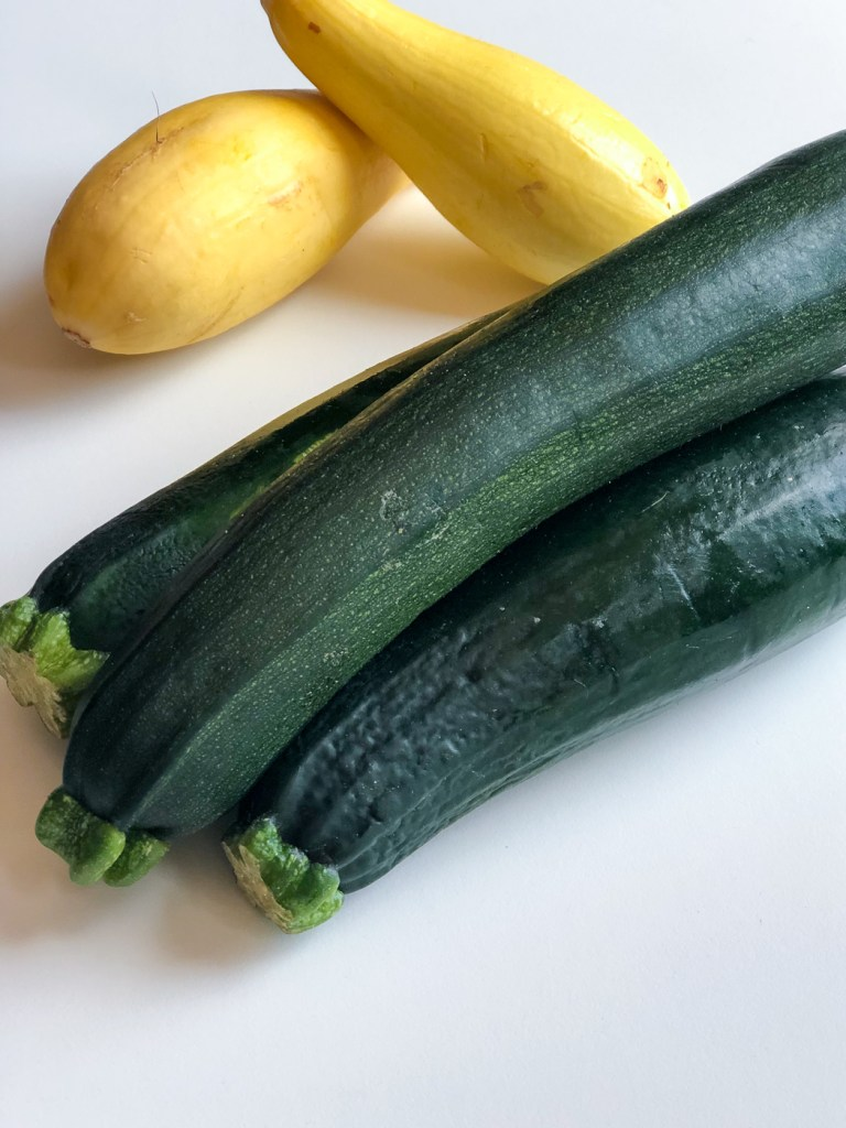 Piled zucchini and yellow squash