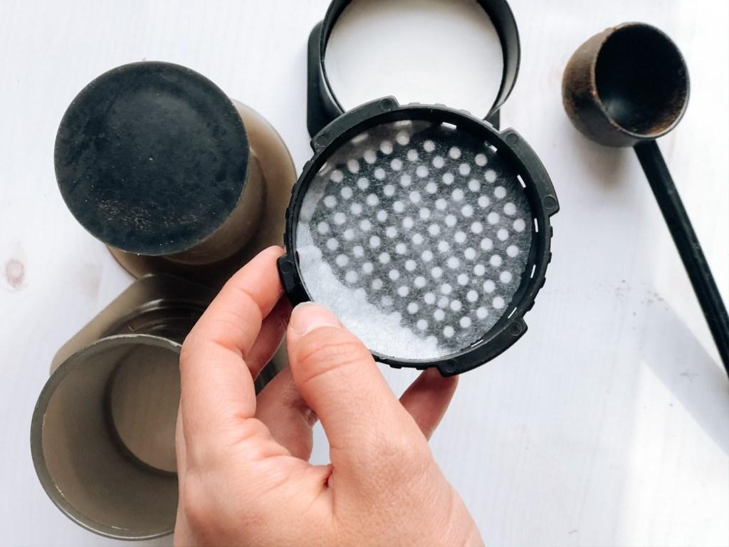 Placing filter in aeropress filter cap