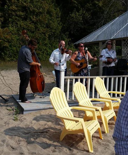 The Heartaches Stringband playing music for a wedding on the shores of Lake Huron